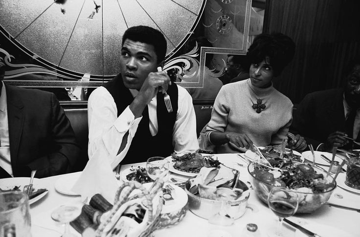 GREAT BRITAIN. London. 1966. World heavyweight champion Muhammad ALI having dinner while in London for a title fight. @magnumphotos by thomashoepker