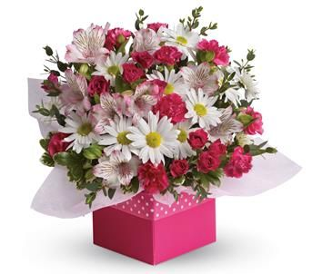 Polka dots and posies, they are the perfect pair. Well, at least in this pretty arrangement they are.