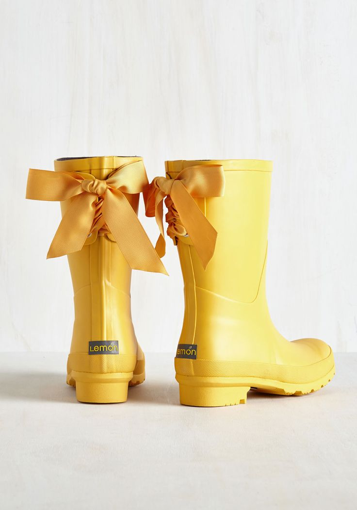 Well, Well, Wellie Rain Boot in Rubber Duck. Can a little rain actually brighten your day? #yellow #modcloth $99