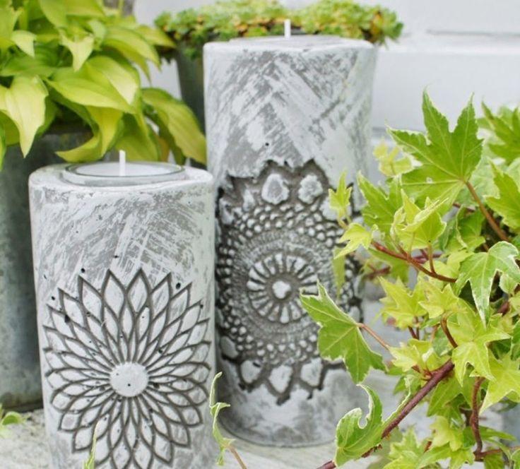 des porte-bougies créatifs en béton décorés d'ornements rosaces