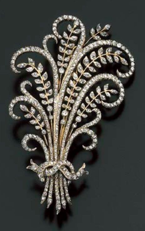 An antique diamond brooch, 19th century. Designed as a bouquet of en tremblant leaves tied with a bow, set throughout with rose-cut diamonds, mounted in silver and gold.