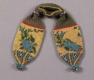American miser's purse, floral motifs, second quarter 1800s, crochet, silk backing, bead embroidery, metal closure rings.