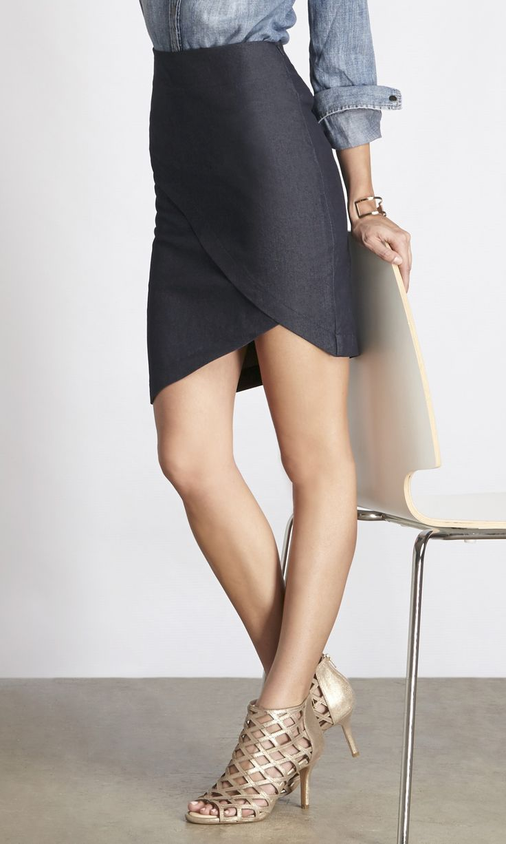 """Soft, angled pencil skirt made from sustainable stretch fabric. Styled with Sole Society""""s gold Portia caged heels."""
