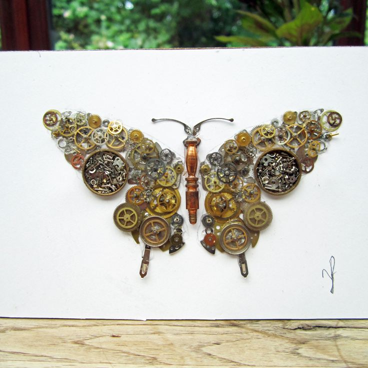 Butter fly picture made from old watch parts
