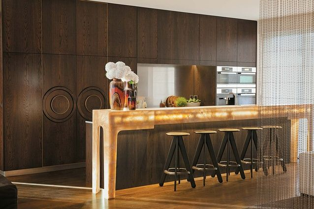 Tom Dixon stools, a custom-designed brass curtain and an onyx benchtop make for an unexpectedly sophisticated room.
