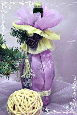 Wine bottle wrapped as a Christmas gift