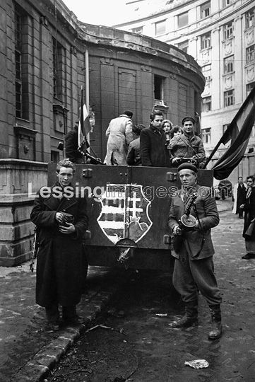 """The """"Kossuth arms"""",the Hungarian national emblem of the republic of 1946, has been painted on a BTR-152 APC armoured car captured by the insurgents. Corvin Lane, October 1956."""