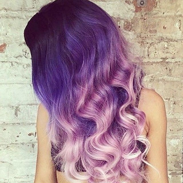 Different shades of colored purple hair. From dark purples roots to light dyed tips. Color. Colour.