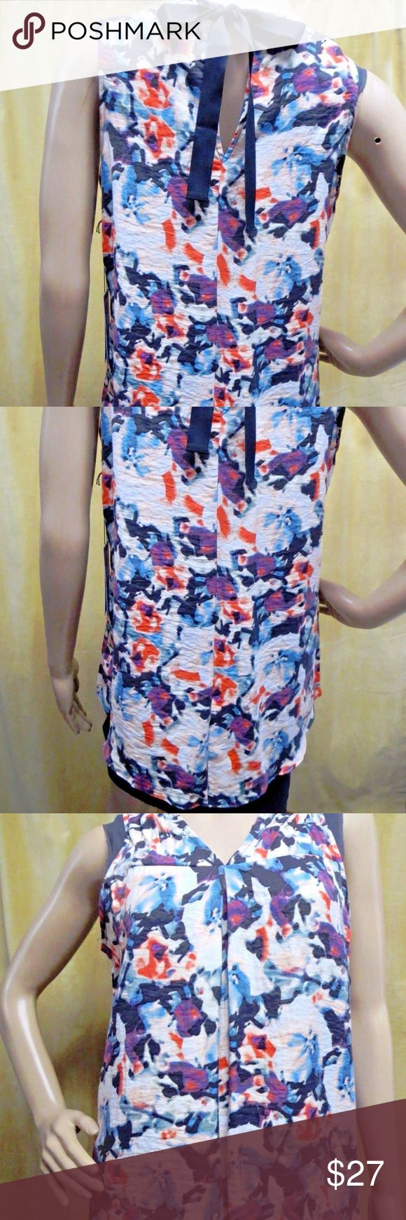 "Simply Vera Wang Tie Neck Watercolor Tunic Petite NWT New Retail $54.00 Pullover V-neckline with pintuck ruching Keyhole ribbon bow tie neckline in back Allover watercolor floral printed Sleeveless Chiffon trim High low rounded hem Woven construction 78% rayon, 22% nylon Hand wash Size PXS:     Chest 17"" across front and length shoulder to hem 22.5"". Size PS :     Chest 18"" across front and length shoulder to hem 23"". Simply Vera Vera Wang Tops Blouses"