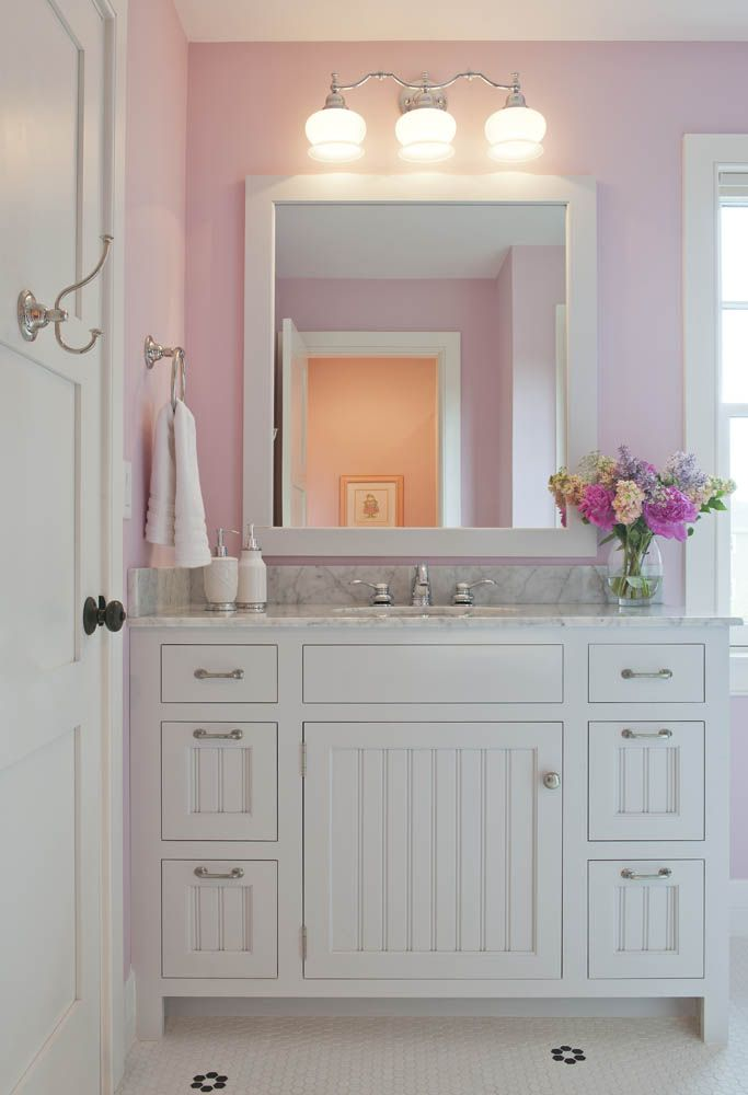 A beautifully feminine vanity features our Coventry door, finished in Blackened by Farrow & Ball
