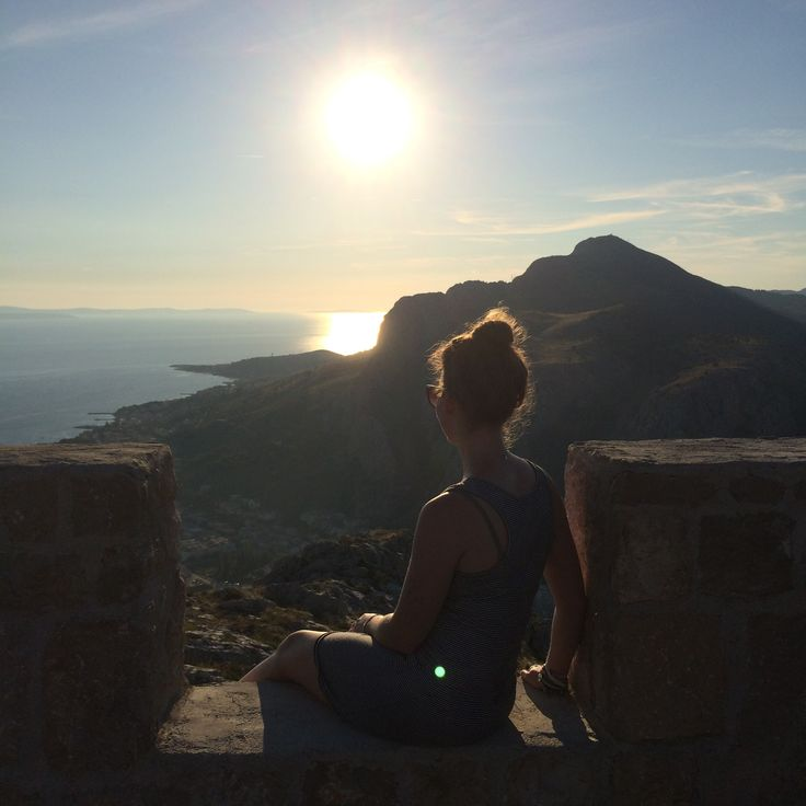 Enjoying the setting sun after a tough climb up to a fort in Omis, Croatia