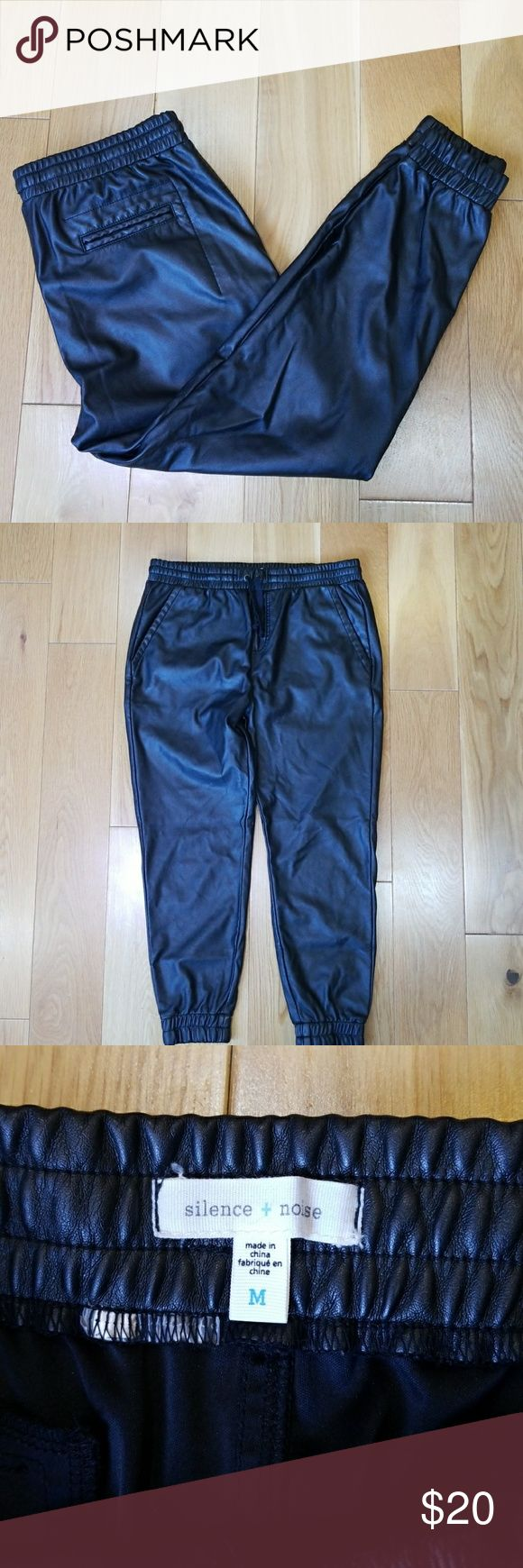 Urban Outfitters Vegan Leather Joggers Pants Cuff Urban Outfitters Silence and Noise Size M Fake Leather Jogger Pants Cuffed Drawstring  All measurements are done with the garment laying flat on a table and measured straight across.  Inseam: 24 inches Hip to Hip: 18 inches across Rise: 10 inches Thigh: 11 inches across Waist: 16 inches across  Size: Medium  Great condition! Barely worn, no visible signs of wear.  Feel free to ask questions! I want to make sure you're getting what you want…