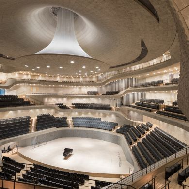 Elbphilharmonie: Architect: Herzog de Meuron Project Location: Hamburg, Germany Project Date: 2017The architects aimed to create a concert hall where anyone can easily enjoy the philharmonic, and not just the elite. The program mix inside helped with this aim where 3 concert halls, a hotel, apartments, cafes, bars, and restaurants all live inside this structure. The upper section of the building is new, sitting above the original brick walls with its expressive glass facades. The curved…