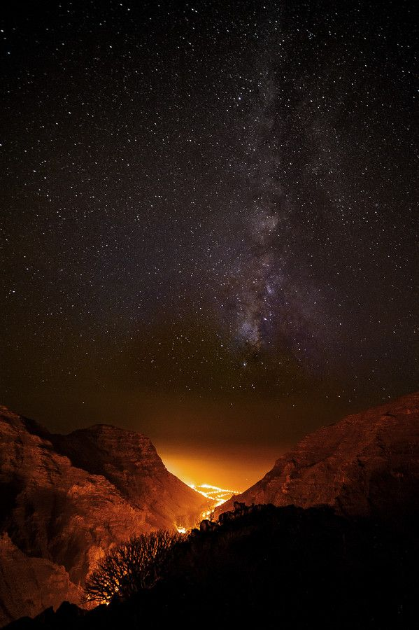 Starry starry night above the lava lights at the Valle Gran Rey on La Gomera in the Canary Islands, Spain