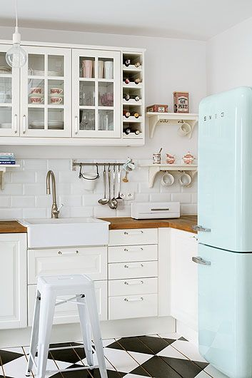 Love the fridge, the floor, the glass-front cupboards.