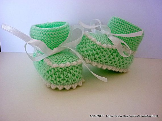 Knitted baby booties/slippers/shoes in mint green with a