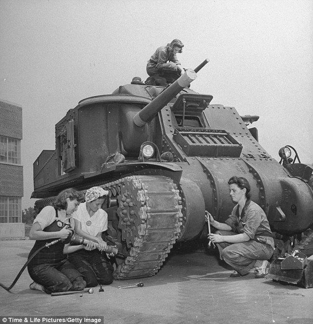 Women mechanics working on an M3 tank at the Aberdeen Proving Ground, MD