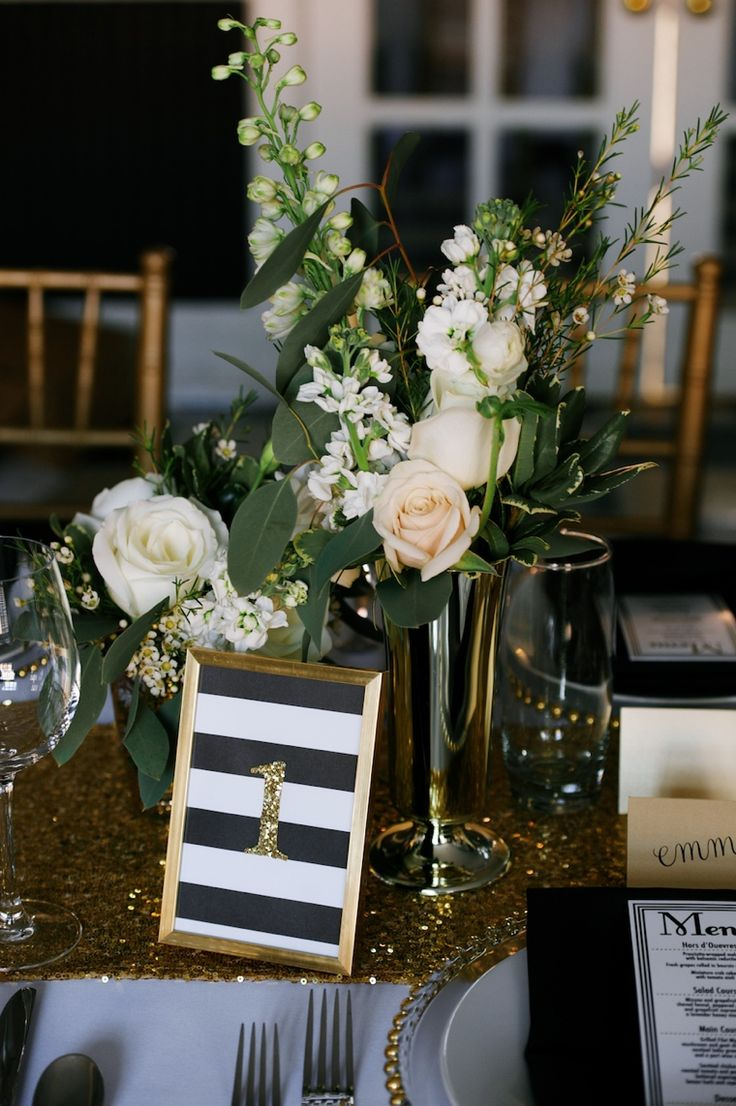 Modern Black and Gold Wedding Ideas  // Love these table numbers in black stripes and glitter numbers.