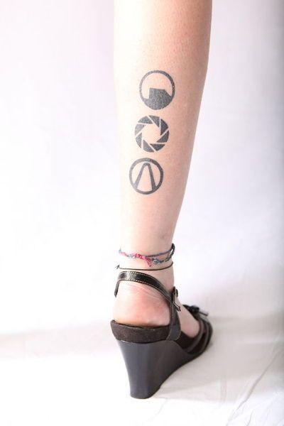 Gaming ink! Black Mesa, Aperture, Vault symbol. Basia Kaminska at MT Tattoos in Redwoood City, CA (January 2013?)