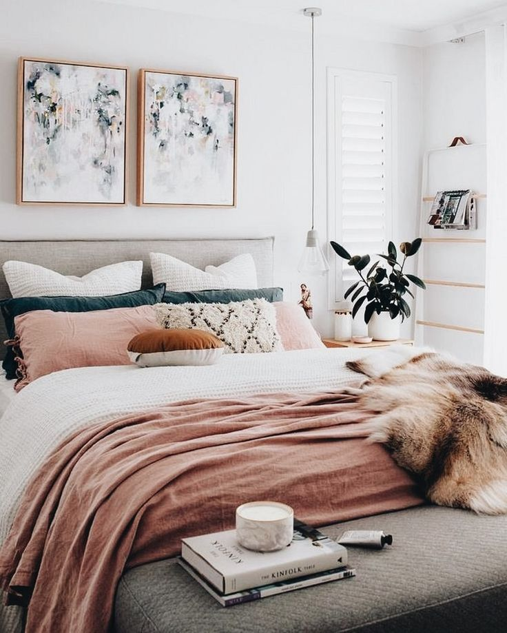 beautiful boho chic bedroom with millennial pink bedding