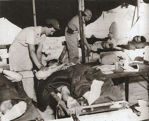 The 8055 MASH, a 60 bed hospital, was the first medical unit to arrive in Korea, in Pusan on July 6, 1950. In an airport Aid Station, 8055 MASH Army Nurse Capt. Phyllis LaConte and Flight Nurse Lt. Marguerite Liebold prepare wounded for travel to hospitals in Japan. August, 1950