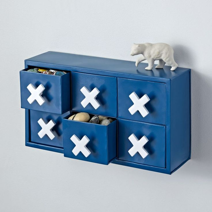 Shop Mini Metal Drawers.  When it comes to this set of metal drawers, X marks the spot for stashing keys, trinkets, and more.  It can be hung on a wall or set on a tabletop.