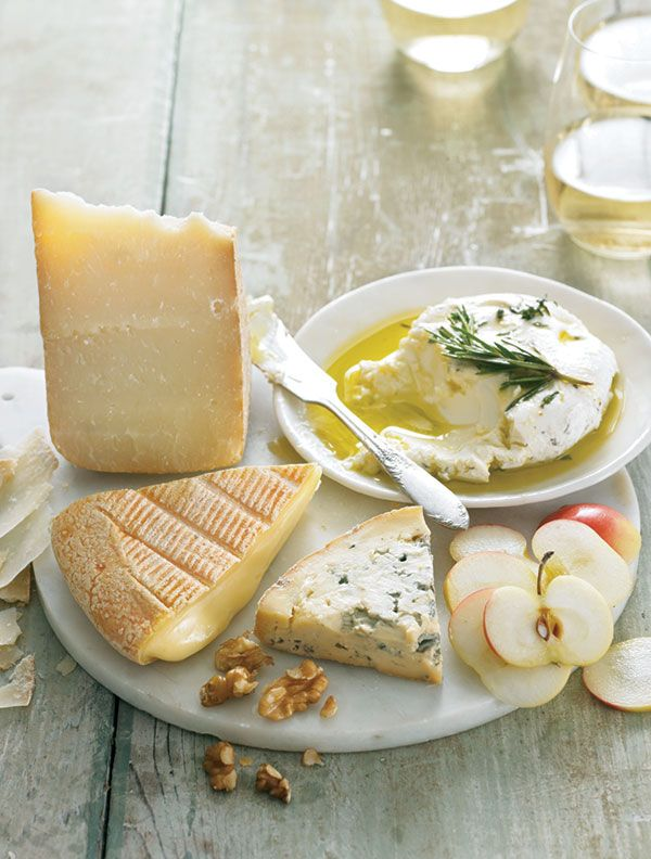 A selection of flavorful cheeses, a big green salad, and a crisp white wine make a light and easy summer meal. Get our tips for building the perfect summer cheese plate.