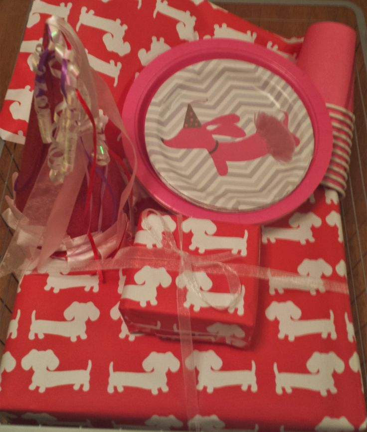 """Gift wrap galore for wiener dog lovers! We had a little doxie party for my 4 yr old niece recently - she loved it. Someone asked her """"when will you be turning four""""...Ellie's answer was """"on my birthday."""" Kids :-)"""
