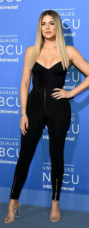 Who made  Khloe Kardashian's clear sandals, black zipper pants, and top?