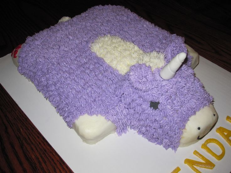 """Unicorn Pillow Pet - Made to match the birthday girl's favorite pillow pet!  A 10"""" square with edges and corners rounded off.  Head baked and carved out of loaf pan.  All buttercream except eyes and horn."""