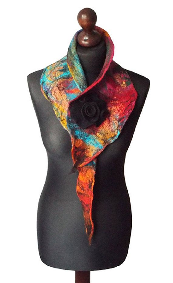 Felted collar/ necklace made from finest Australian merino wool and hand dyed cotton gauze. Lightweight and soft to the touch. Colors: multicolor, black. Necklace with felted flower brooch - metal pin closure. Size: length: 112cm (44,09) width: 5 - 18cm (1,97 - 7,09)  Technique: wet felting.  Visit my fan page on Facebook: www.facebook.com/pracownia.artystyczna.arteduo  More scarves you can find here: www.etsy.com/shop/MarlenaRakoczy?section_id=14901313&ref=s...