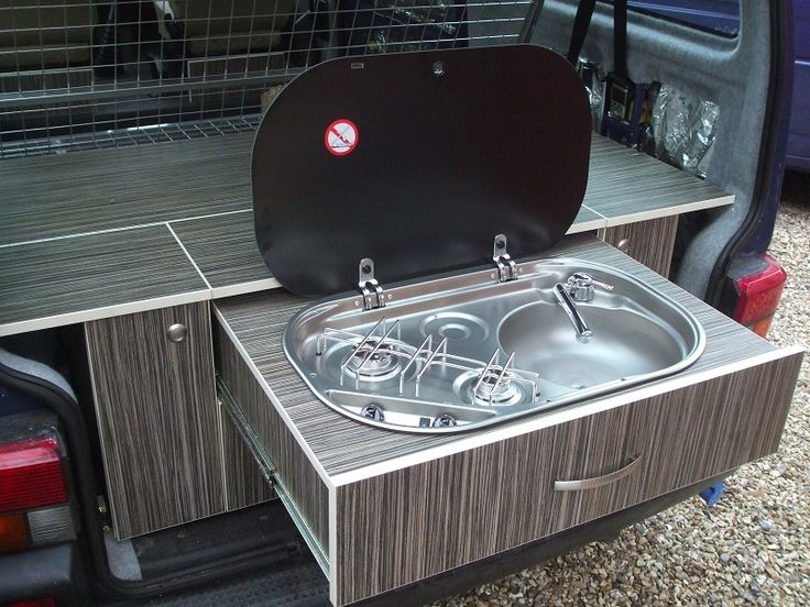Really clever slide-out rear kitchen, combined with some slide-out side units too and it'd have everything. PLUS the platform can then be used as both a sofa and a bed... meaning the whole inside of the van could be sofa/bed!