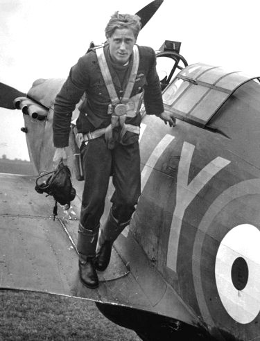 Royal Air Force ace Pilot Officer Albert Gerald Lewis DFC, of 85 Squadron, climbs out of his plane after an air battle in the skies over England - Battle of Britain - 1940