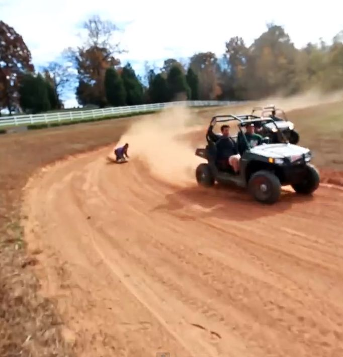 Watch Dale Earnhardt Jr. sit in a hot pink Barbie car that's attached to an ATV that gets dragged around a dirt track! A little like water skiing but without the water! How much fun does this look?!?! Watch here >> http://www.carhoots.com/blog/celebrity-cars/stock-car-racer-dale-earnhardt-jr-gets-dragged-around-the-roads-in-barbie-car-video