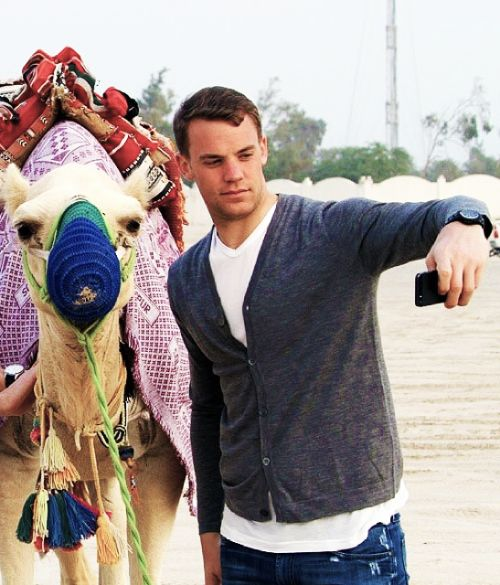 Here's a picture of Manu taking a selfie with a camel