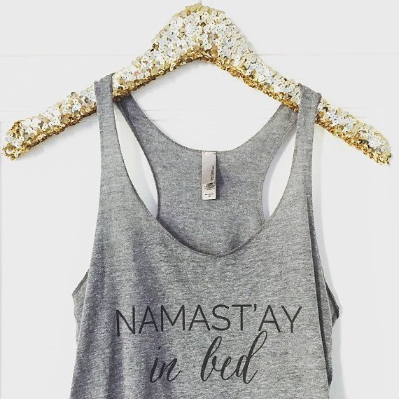 Namastay In Bed Racer Back Tank Top Designed + Printed exclusively by Sweet Water Decor!  This heathered loose fitting tank is perfect for