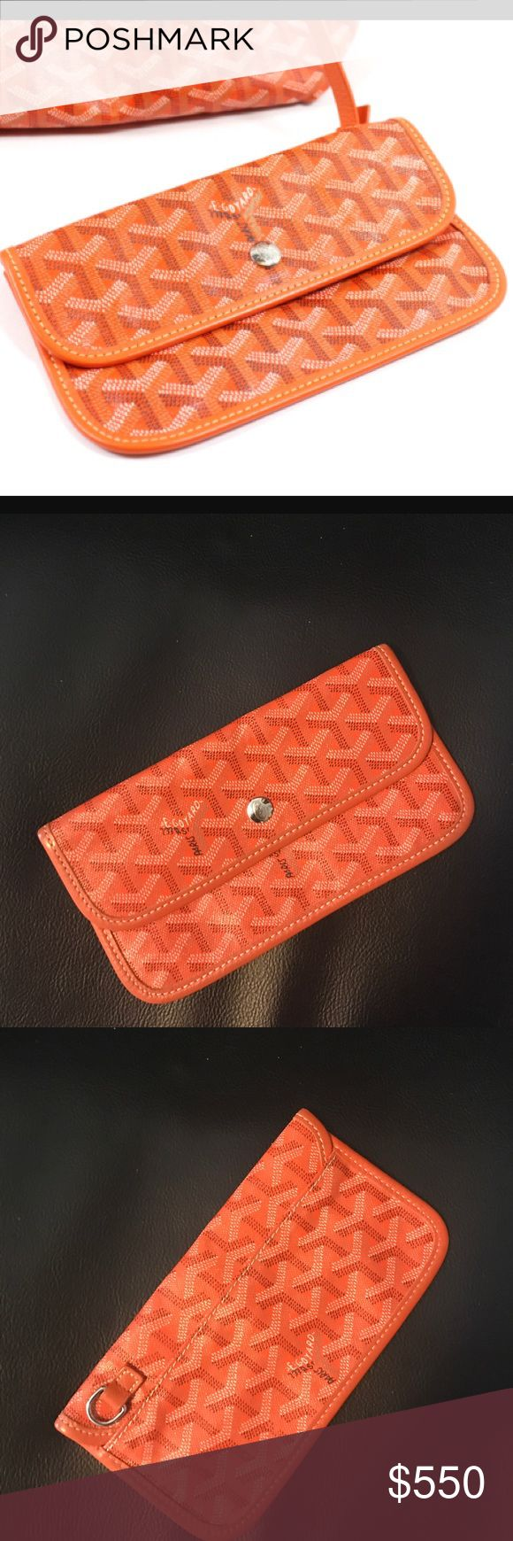 •MUST HAVE 100% AUTHENTIC GOYARD SIGNATURE POUCH• •MUST HAVE 100% AUTHENTIC GOYARD SIGNATURE POUCH- THE CODE IS ON THE PURSE POSTED SO THERE IS NOT ONE ON THE POUCH. WORN 2x LIKE NEW CONDITION. IF YOU MAKE A HIGH ENOUGH OFFER IT WILL GO THROUGH POSH AUTH SERVICES. GREAT SIZE FITS IPHONE 7+. PURCHASED IN BLOOMINGDALES. •••PRICED TO SELL SAME DAY, OFFERS WELCOME THROUGH THE OFFER OPTION, NO TRADES OR HOLDS••• Goyard Bags Wallets