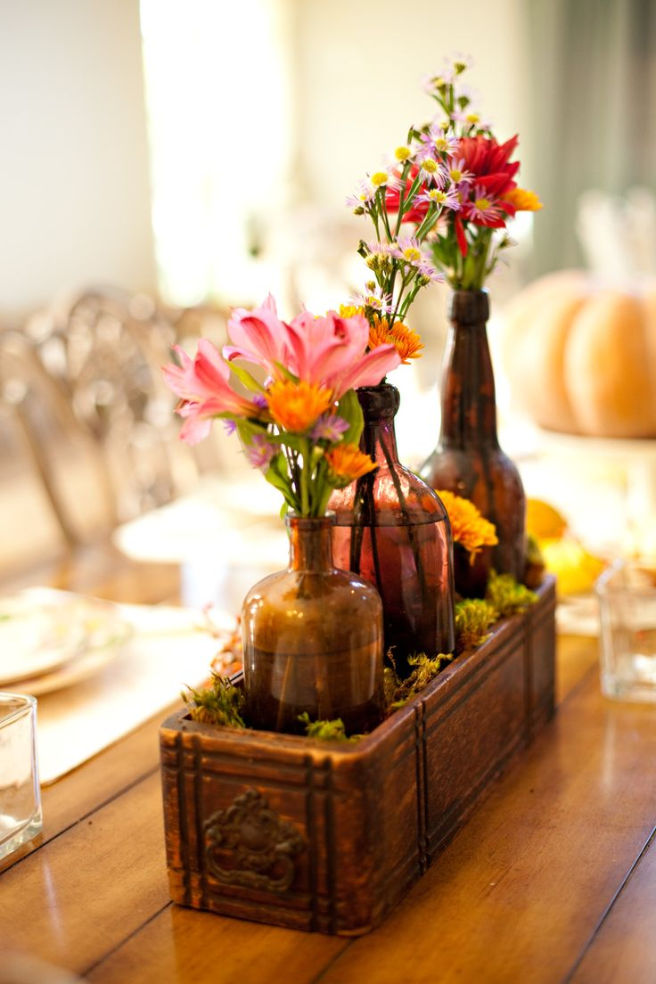 sweet centerpiece with our vintage sewing machine drawer and amber bottles | Pretty Vintage Rentals