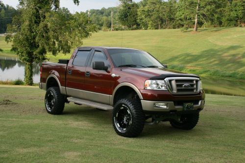 2003 King Ranch F-150 6in lift 35 inch tires on 18in Moto Metal Rims