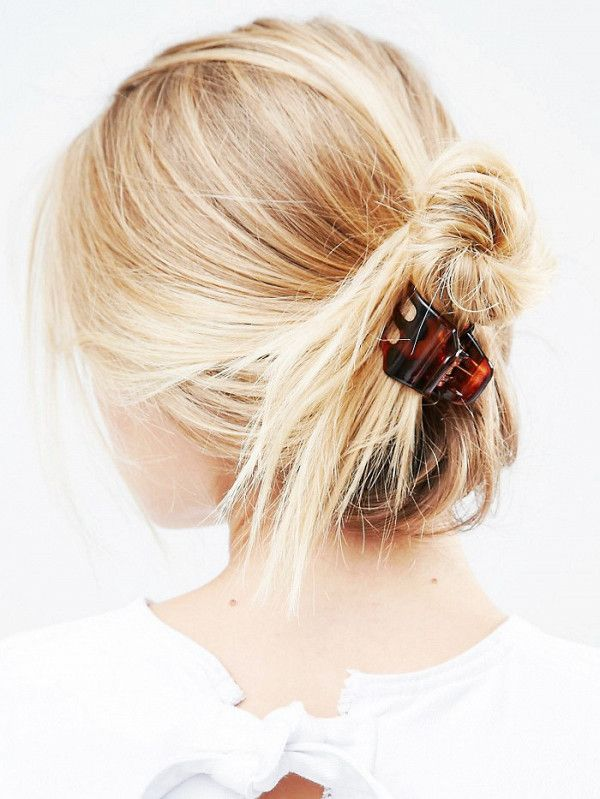 A French twist styled with a hair claw