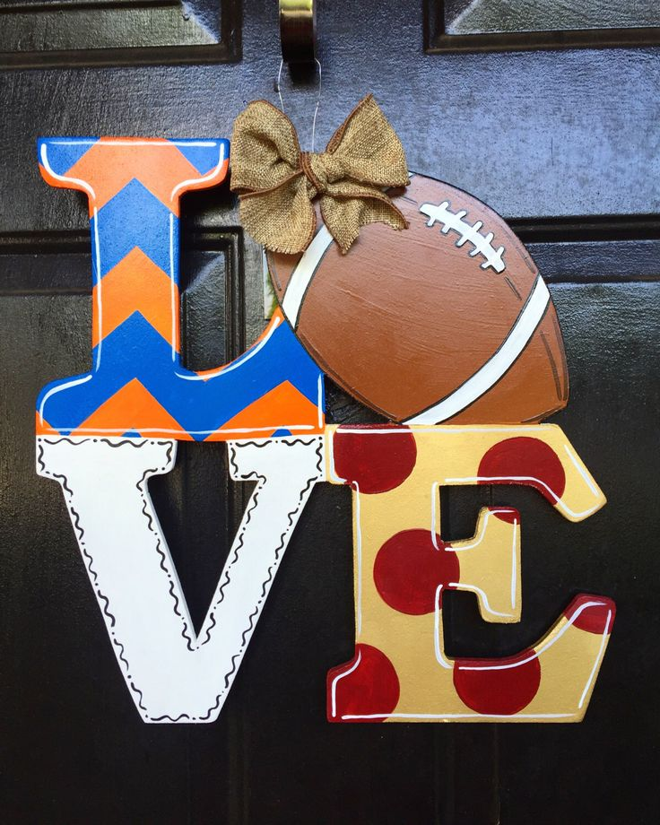 A personal favorite from my Etsy shop https://www.etsy.com/listing/453969214/love-football-house-divided-door-hanger