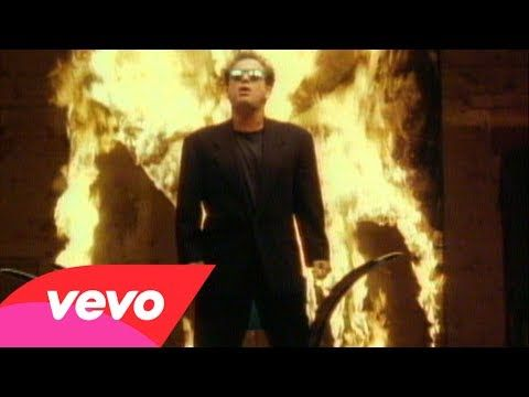 Billy Joel - We Didn't Start the Fire Surprised myself!  I still remembered the lyrics after a few decades.