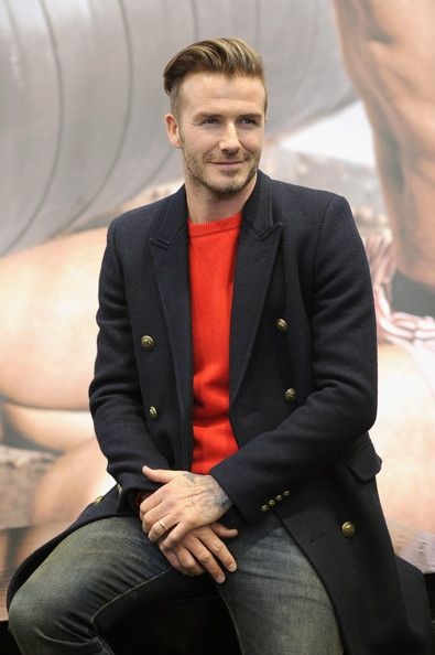 Beckham in a coat and bright sweater. #menswear #style