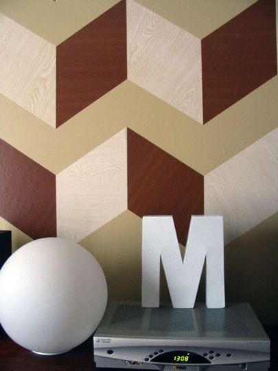 Before & After: Maude's Graphic Woodgrain Wall