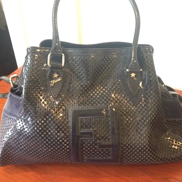 Perforated leather blue fendi purse All blue and all leather Fendi purse. It is not new because I have used it multiple times but there is no damage to the purse. One zipper pocket inside. See additional pictures in other post. FENDI Bags Shoulder Bags