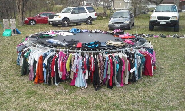 Garage sale idea for when you have a lot of clothes.......if only I had a trampoline.