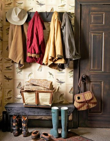 This mudroom's walls are decoupaged with color copies of seven antique bird prints.
