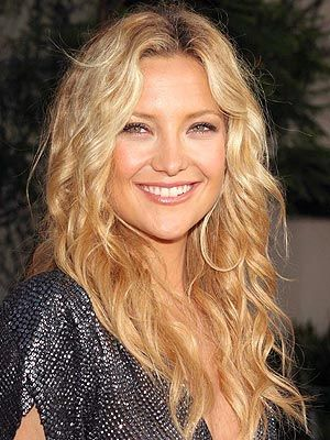 Kate Hudson looks wonderful with a golden hair color and cascading curls.