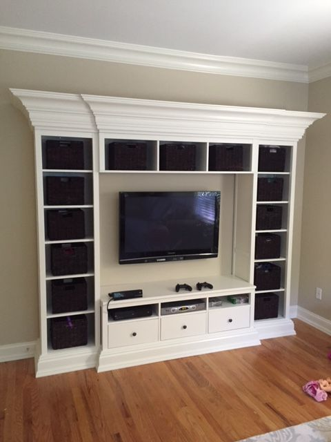 Hemnes IKEA hack with crown and base molding - Kids room entertainment and toy storage unit
