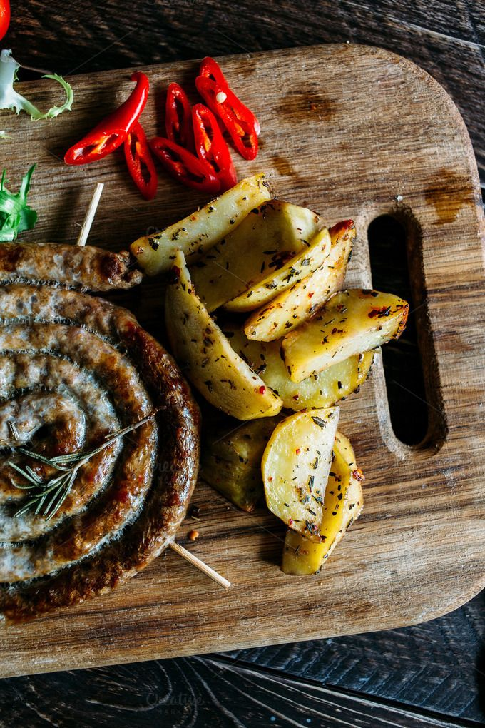 grilled sausage and potatoes by Kate Voronina on @creativemarket